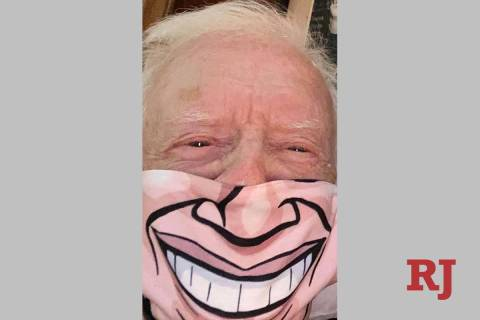 Jimmy Carter is shown wearing a customized face cover in a photo he sent to his friend and Bell ...
