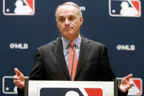 In this Nov. 21, 2019, file photo, baseball commissioner Rob Manfred speaks to the media at the ...