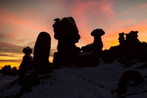 A dramatic sunset behind some of the thousands of hoodoos in Goblin Valley State Park. (L.E. Ba ...