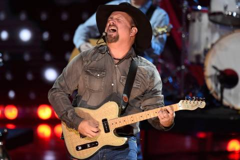 This March 14, 2019 file photo shows Garth Brooks performing at the iHeartRadio Music Awards in ...