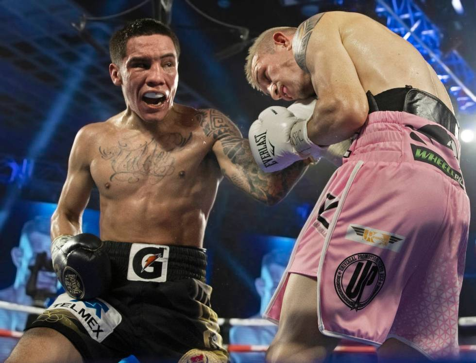 Oscar Valdez, left, lands an uppercut against Jayson Velez during their jr. lightweight fight d ...