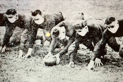 This 1918 Washington University file photo shows the university football players wearing protec ...