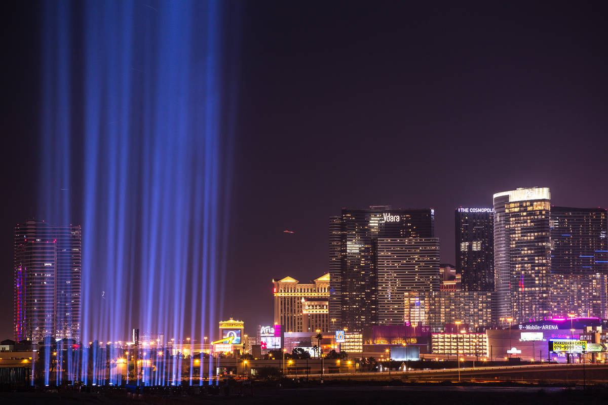 Lights are lit up at the construction site of the Raiders stadium in Las Vegas, Monday, Nov. 13 ...