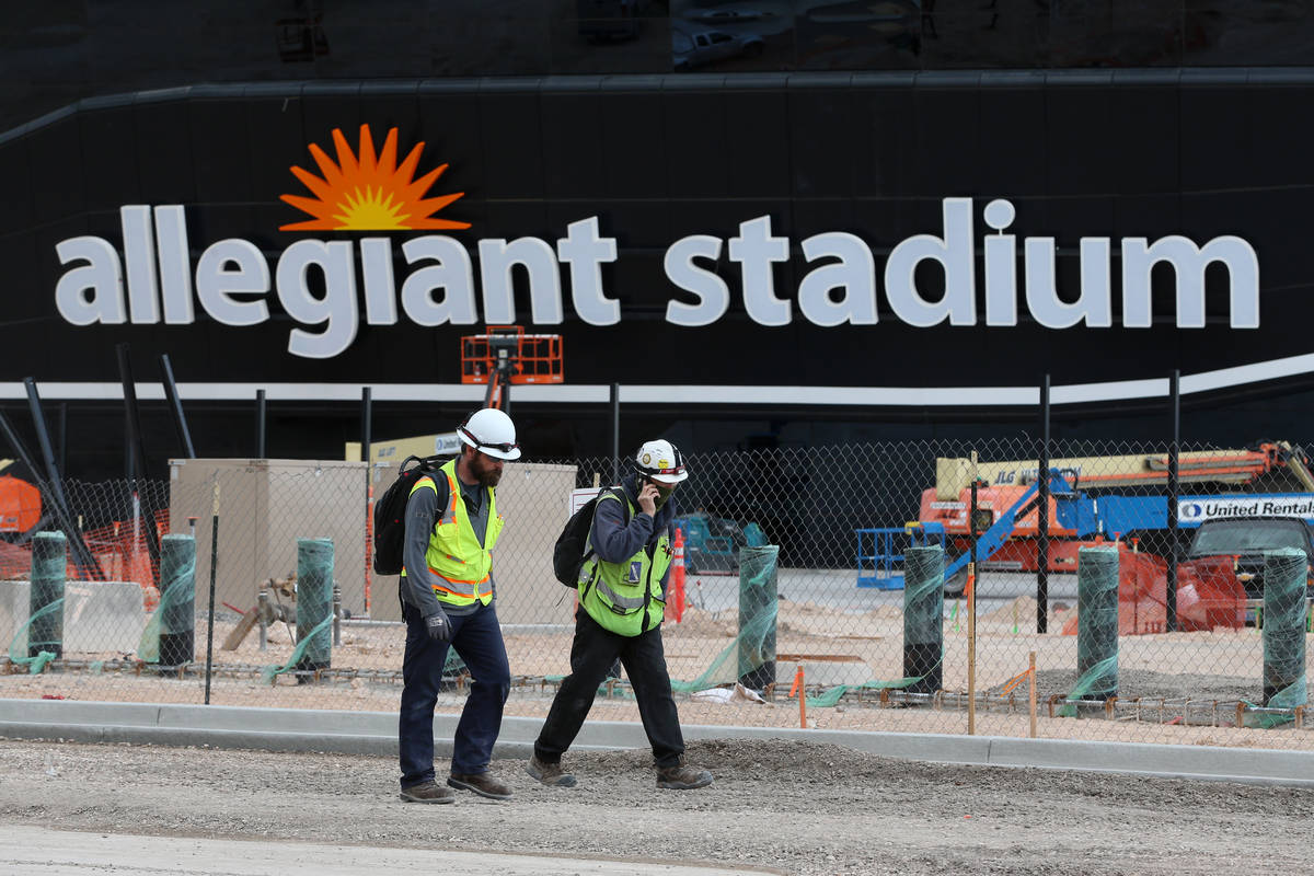 Workers leave at the end of their shift at the Raiders Allegiant Stadium in Las Vegas, Wednesda ...
