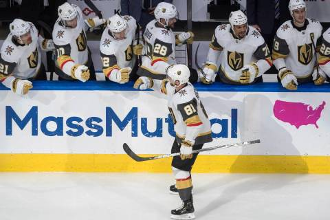 Vegas Golden Knights' Jonathan Marchessault (81) celebrates a goal with teammates during third ...