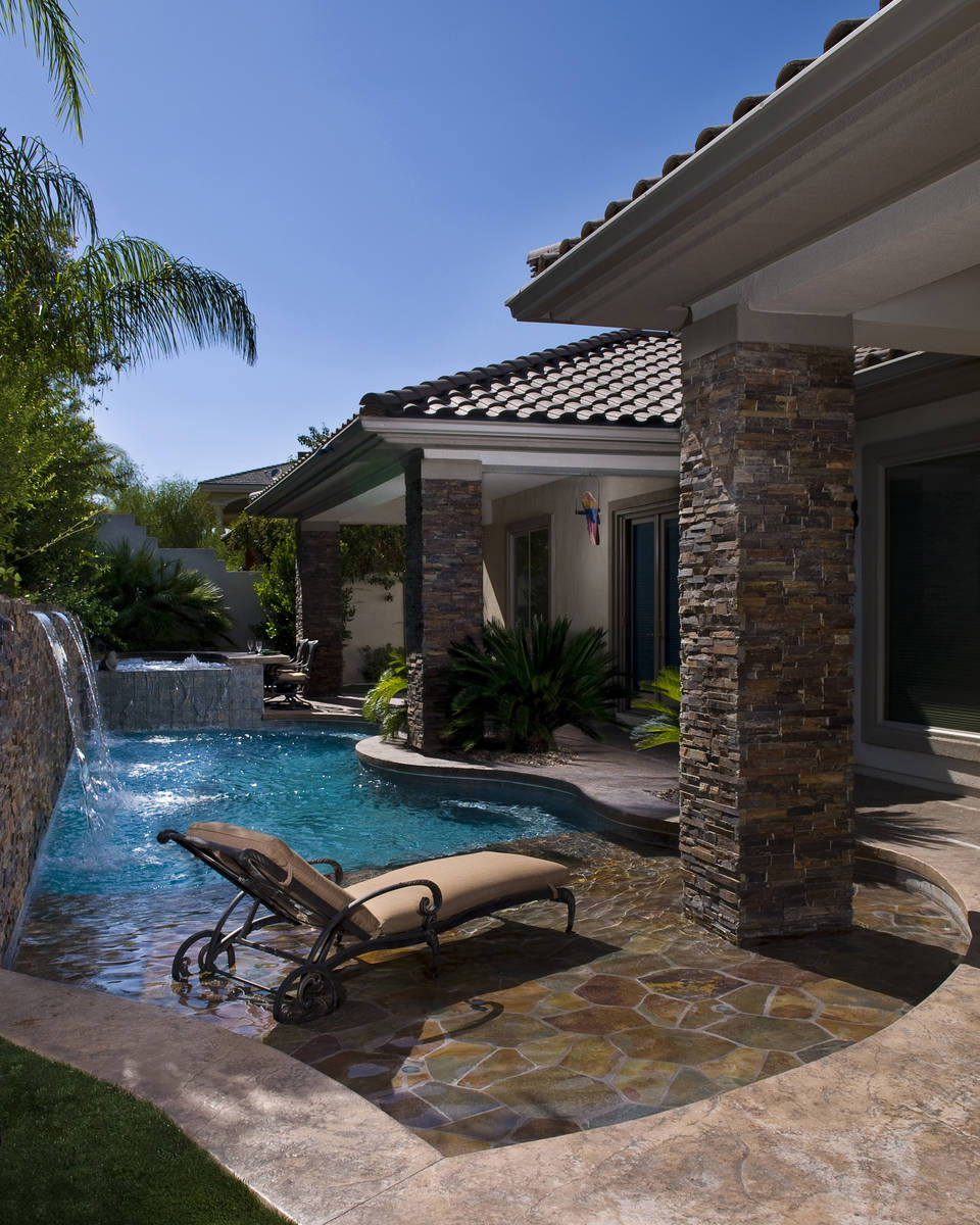 This small backyard pool has a water feature, wet deck and spa with its own bar. (Premier Pools ...