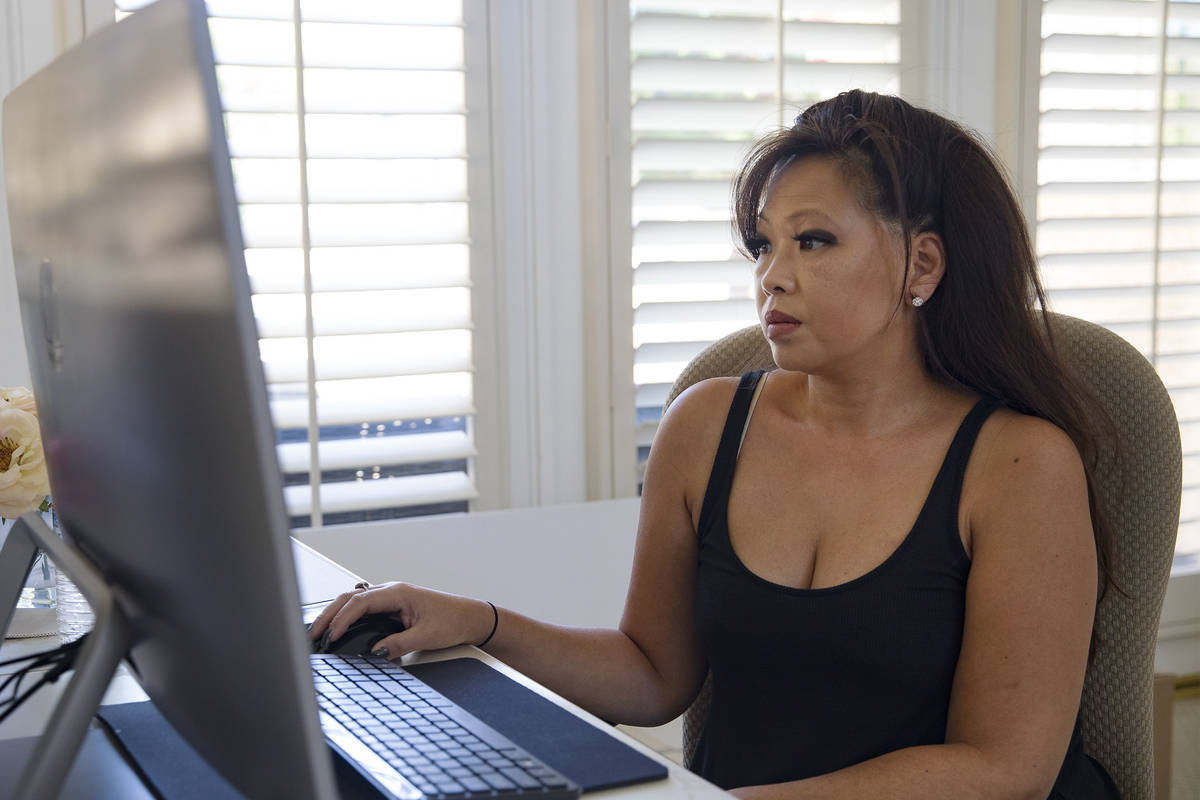 Michelle Lau watches one of the court cases involved with the unemployment office being streame ...