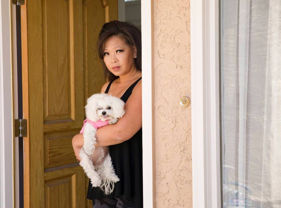 Michelle Lau with her dog Abigail at her home in Las Vegas, Thursday, July 30, 2020. (Rachel A ...