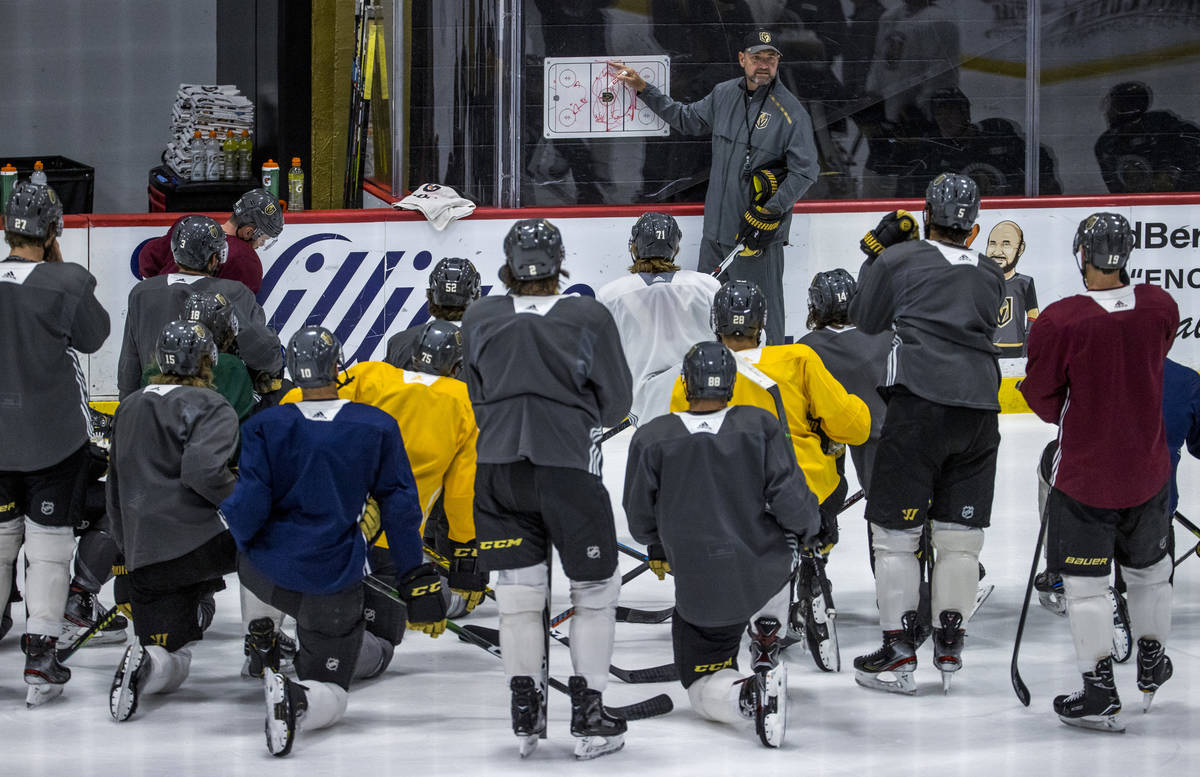 Vegas Golden Knights head coach Peter DeBoer talks about the next drill to his players during p ...