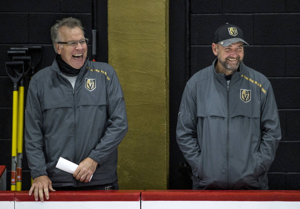 Vegas Golden Knights head coach Peter DeBoer, right, laughs with assistant head coach Ryan McGi ...