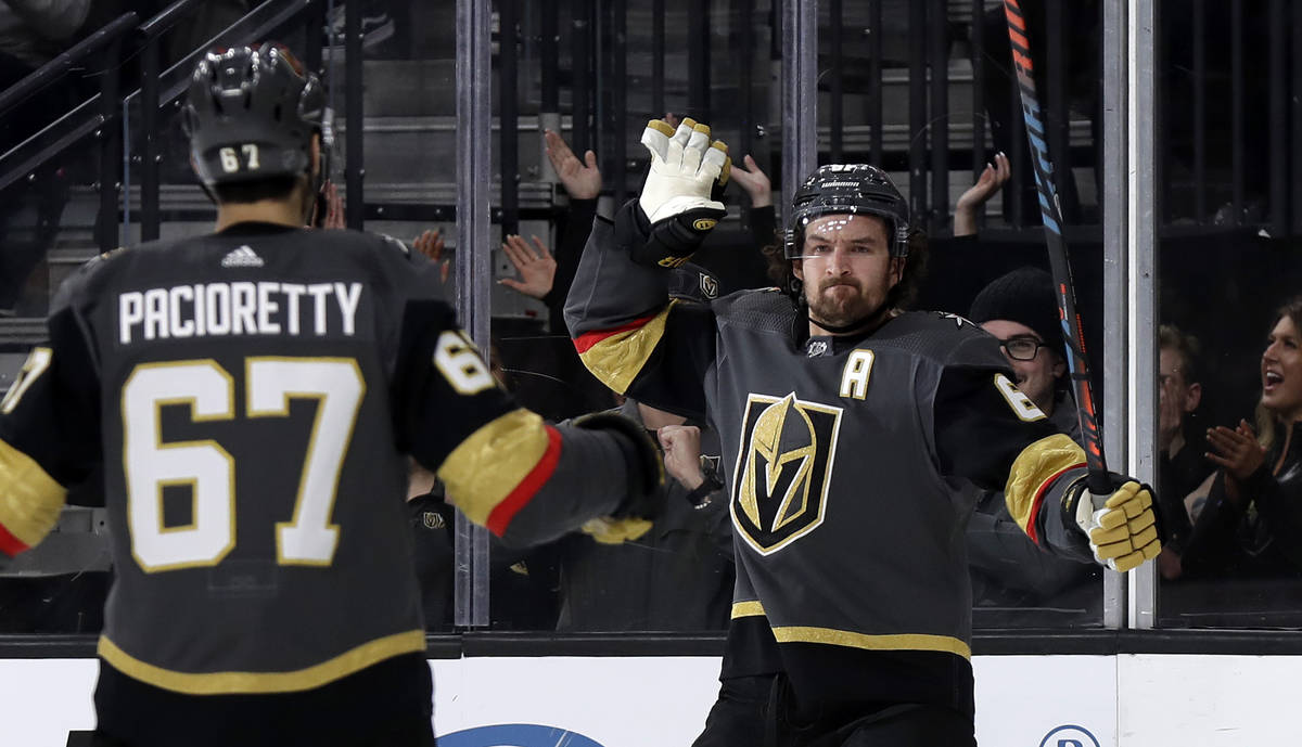 Vegas Golden Knights right wing Mark Stone, right, celebrates with left wing Max Pacioretty aft ...