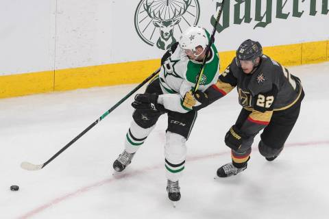 Dallas Stars' Radek Faksa (12) and Vegas Golden Knights' Nick Holden (22) battle for the puck d ...