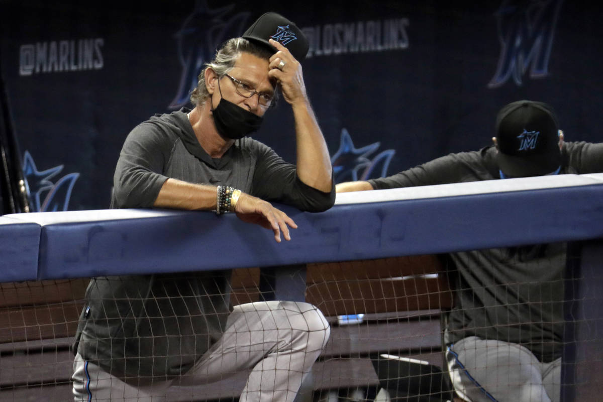 FILE - In this Sunday, July 12, 2020, file photo, Miami Marlins manager Don Mattingly watches a ...