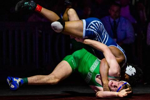 Foothill's Micah Schneider, top, drives Green Valley's Derek Recktenwald into to the mat in the ...