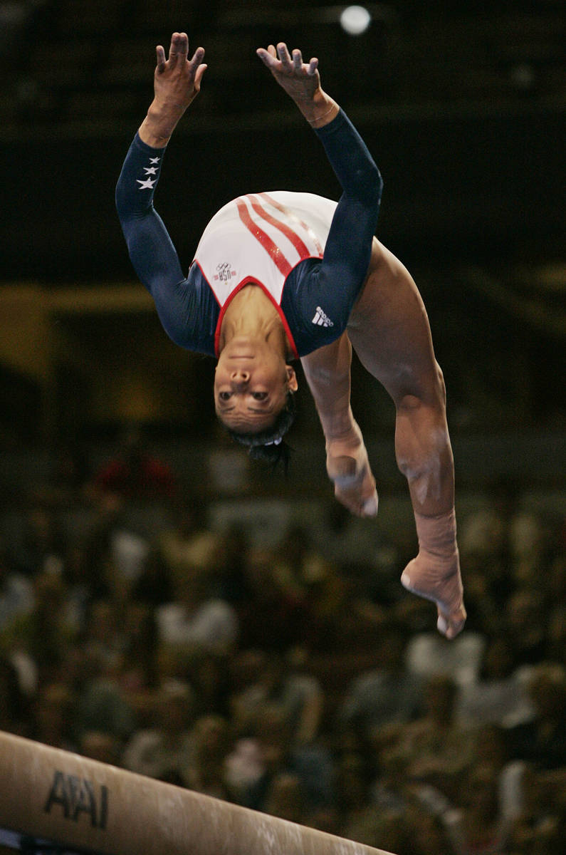 Tasha Schwikert, of Las Vegas, performs on the balance beam during preliminaries at the U.S. Ol ...
