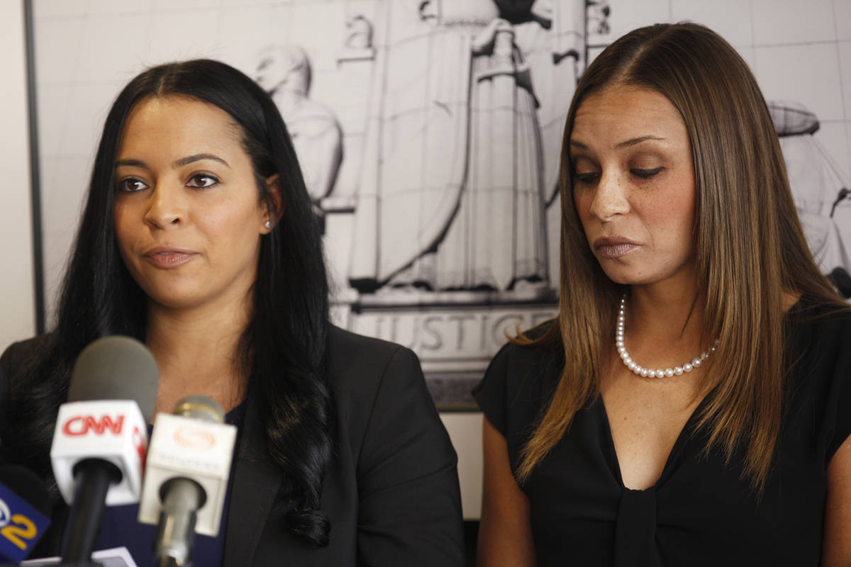 Tasha Schwikert, left, addresses the media next to her sister Jordan Schwikert at the offices o ...