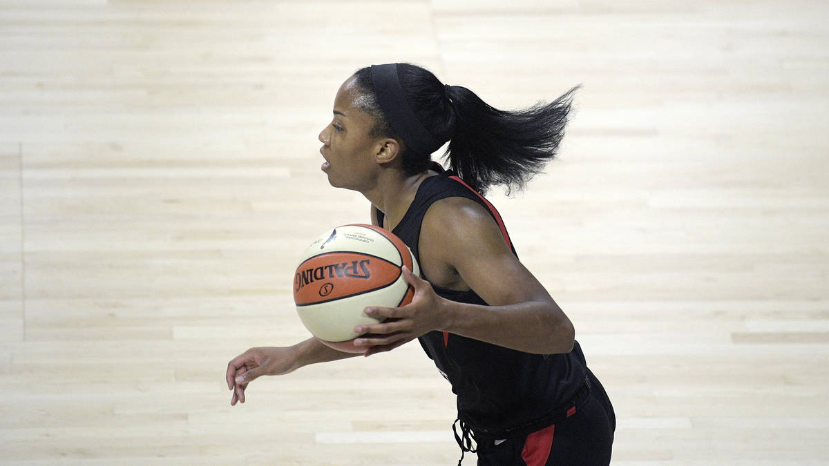Las Vegas Aces guard Lindsay Allen pushes the ball up the court during the first half of a WNBA ...