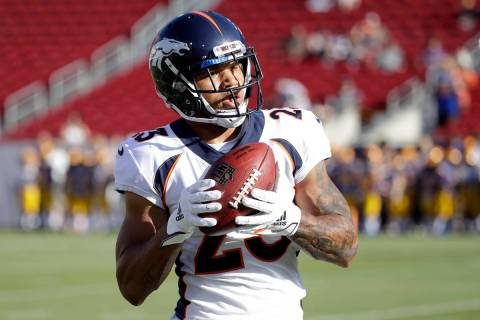 Denver Broncos running back Devontae Booker warms up before the start of an NFL preseason footb ...