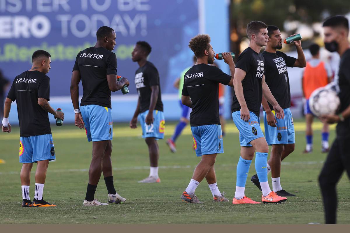 Lights FC players hydrate before the start of a USL soccer game between the Las Vegas Lights FC ...