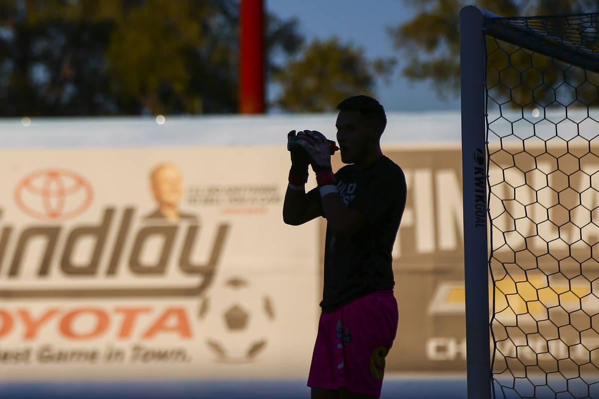 Las Vegas Lights FC goalkeeper Edward Delgado hydrates before the start of a USL soccer game ag ...