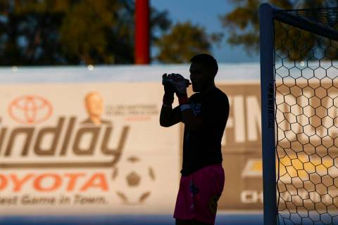 Las Vegas Lights FC goalkeeper Edward Delgado hydrates before the start of a USL soccer game ag ...