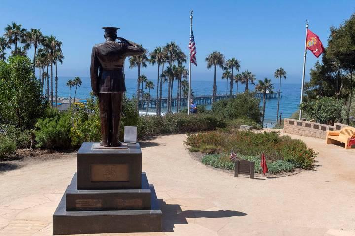 Former San Clemente Mayor Wayne Eggleston lowers the U.S. flag to half-staff at Park Semper Fi ...