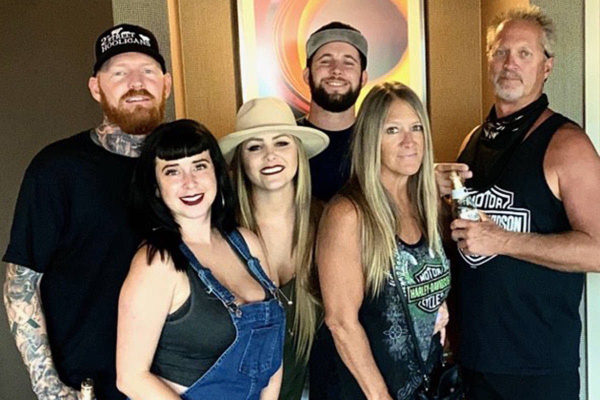 Ryan Dannettelle (left), his girlfriend Ashley Wyrick and the Mock family pose for a picture in ...