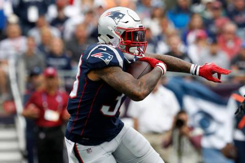 New England Patriots' Jeremy Hill runs against the Houston Texans during an NFL football game a ...