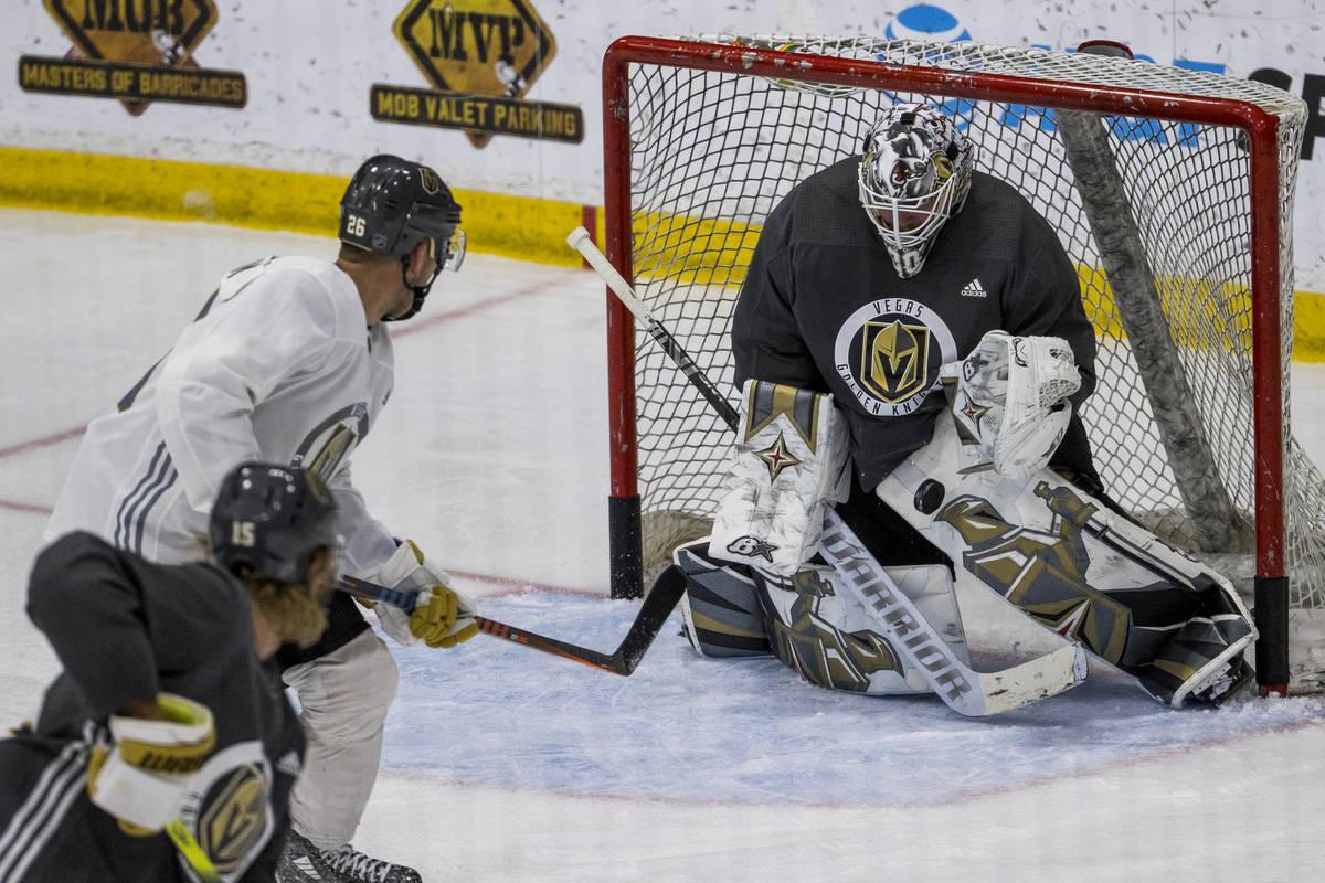 Vegas Golden Knights center Paul Stastny (26, left) has a shot stopped by goaltender Robin Lehn ...