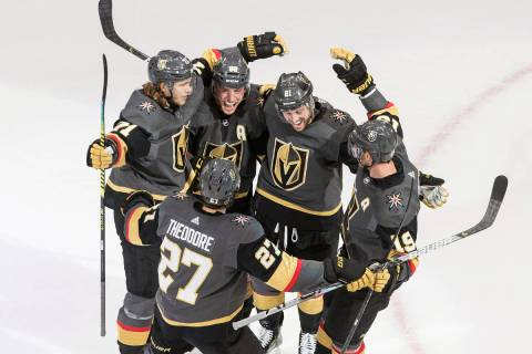 Vegas Golden Knights celebrate a goal during the third period of an NHL hockey playoff game aga ...