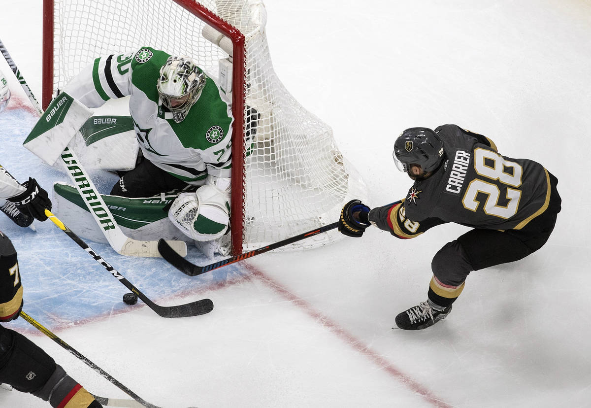 Dallas Stars goalie Ben Bishop (30) makes the save on Vegas Golden Knights' William Carrier (28 ...