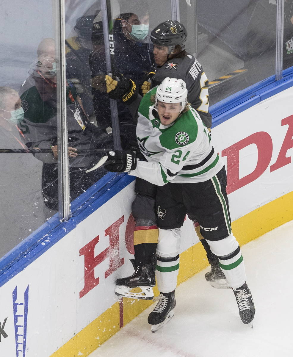Dallas Stars' Roope Hintz (24) checks Vegas Golden Knights' Zach Whitecloud (2) during the firs ...