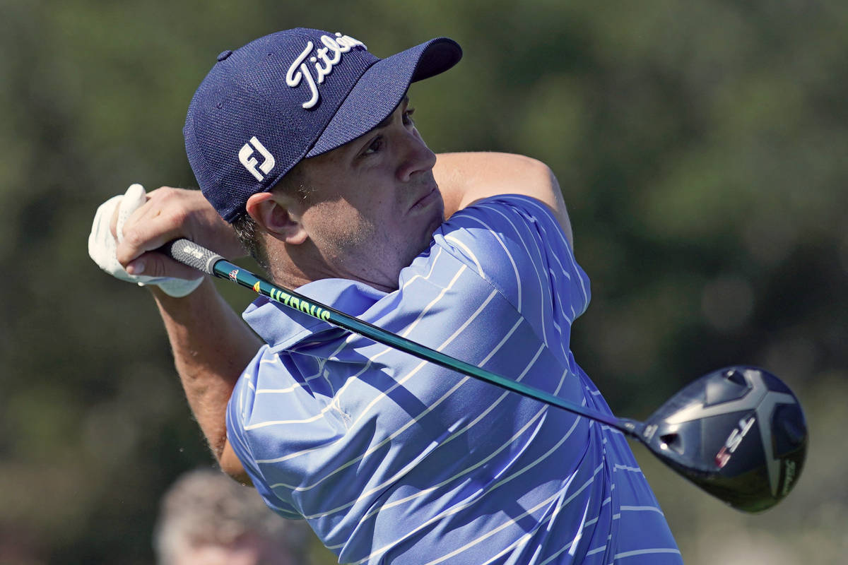 In a Feb. 12, 2020, file photo, Justin Thomas hits his tee shot on the 17th hole during the Gen ...