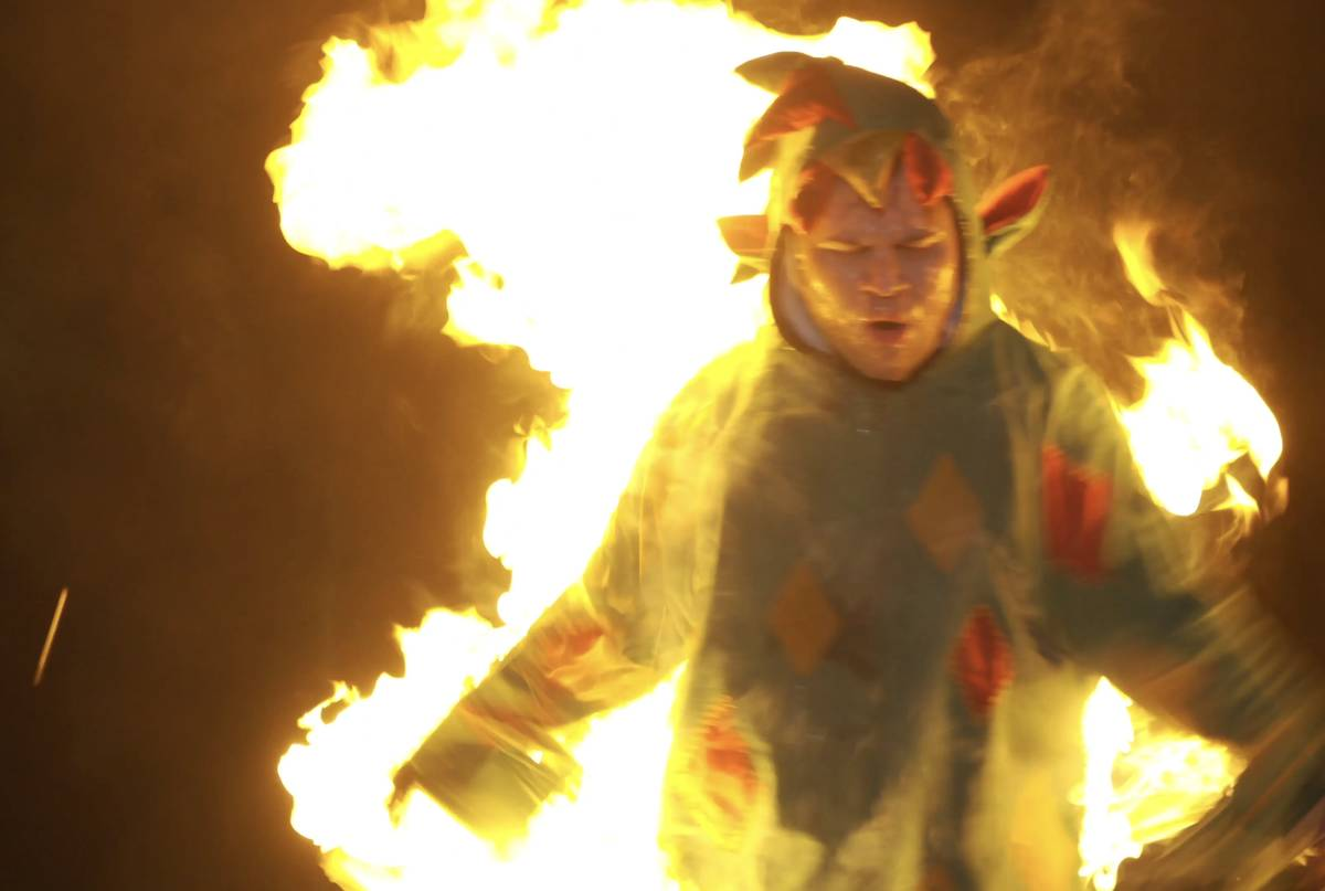 """Piff the Magic Dragon attempts to escape a flaming stake in his winning """"Tournament of Laughs"""" ..."""