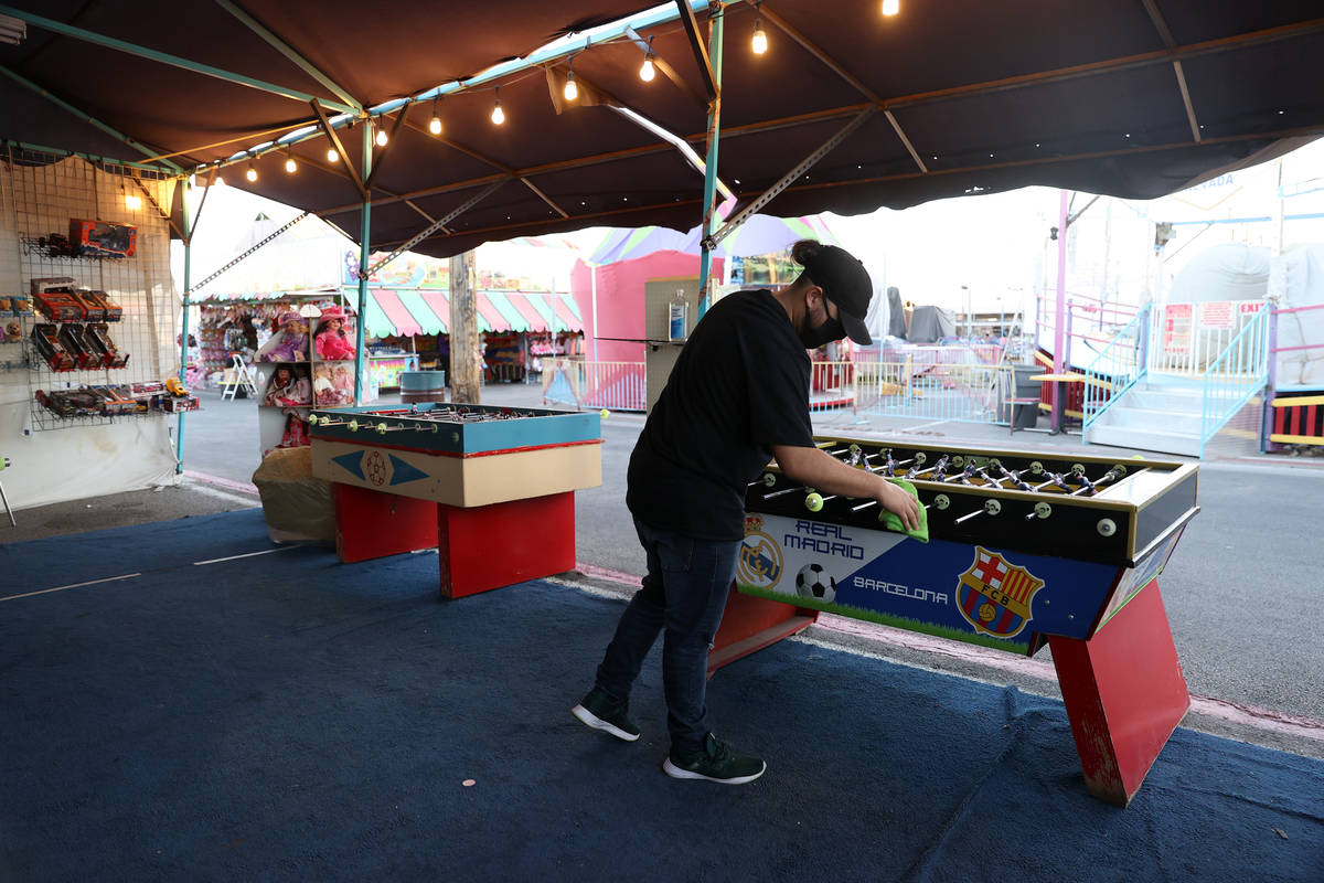 Shop owner Luis Arturo Cordoba Reyes cleans his foosball tables at Broadacres Marketplace in No ...