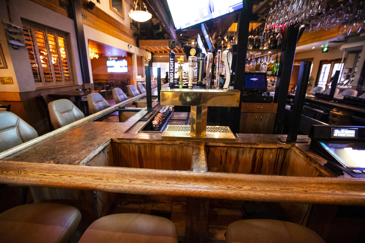 Empty spaces at the bar where bartop gaming machines formerly were at Black Mountain Grill in H ...