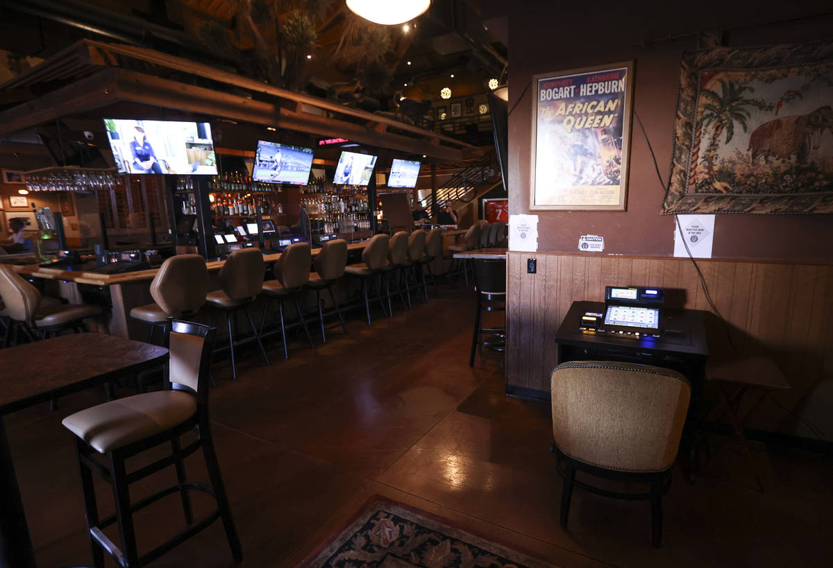 A gaming machine that was formerly at the bar is seen in a lounge area at Black Mountain Grill ...