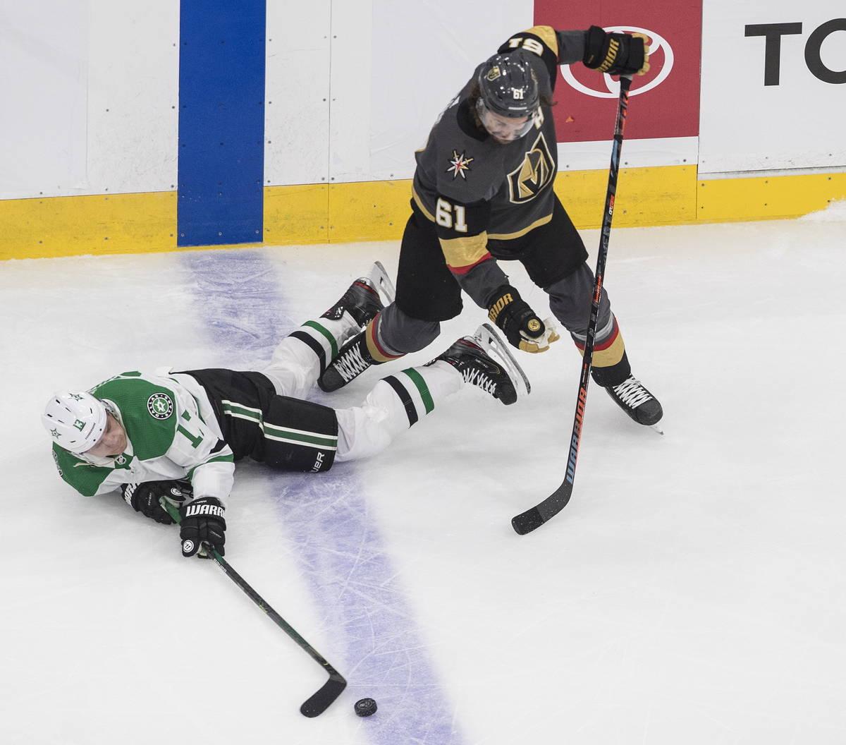 Dallas Stars' Mattias Janmark (13) is tripped up by Vegas Golden Knights' Mark Stone (61) durin ...