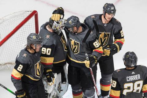 Vegas Golden Knights celebrate a win over the Dallas Stars in an NHL hockey playoff game Monday ...