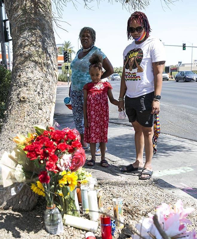 Ana Hardware, left, Tiffany Joseph and her daughter Jordan, 6, visit a makeshift roadside memor ...