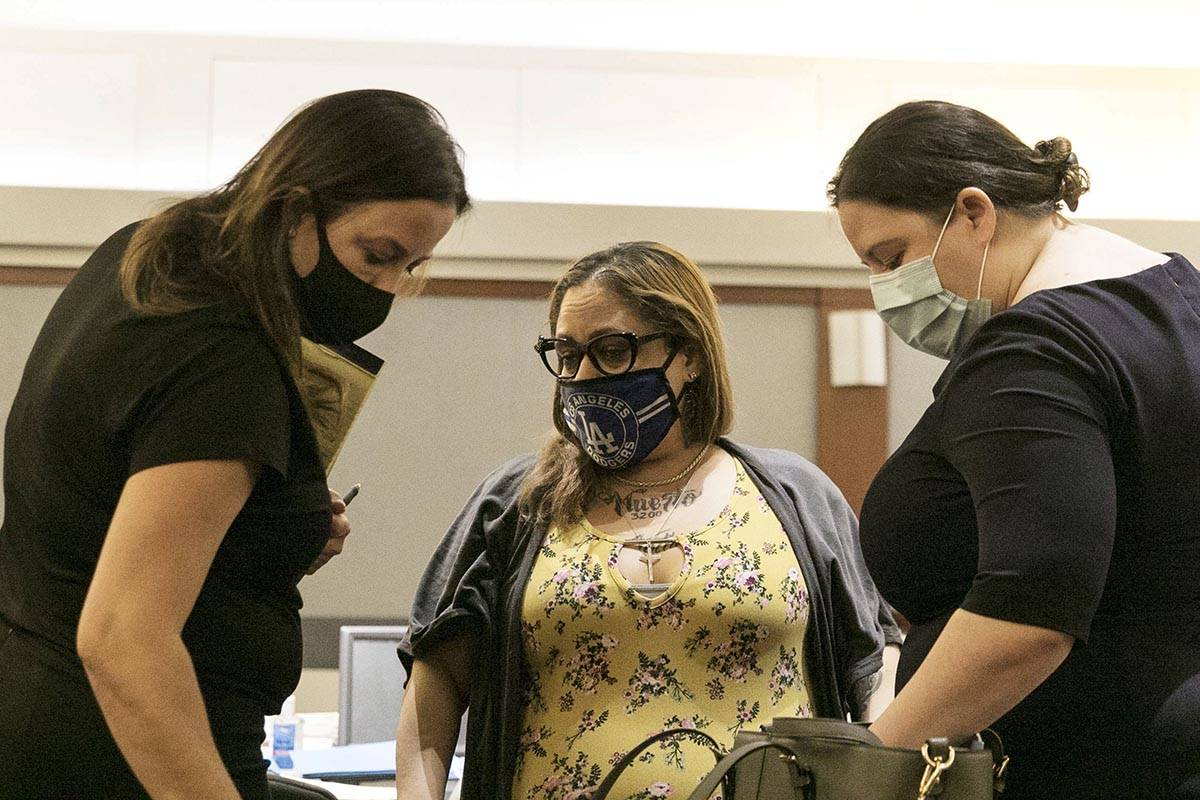 Malinda Mier, center, the co-defendant in the Alpine Apartments fire case, appears in court wit ...