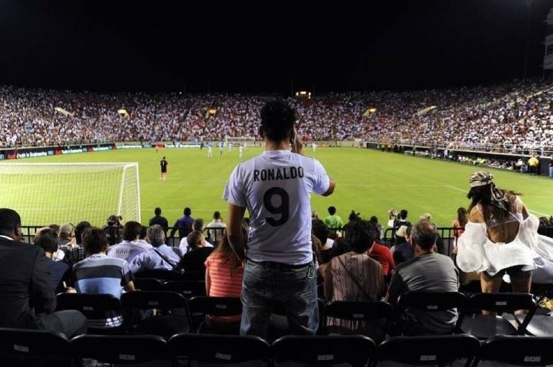 A Cristiano Ronaldo fan takes a photo from the end zone seats during the the Aug. 5, 2012 frien ...
