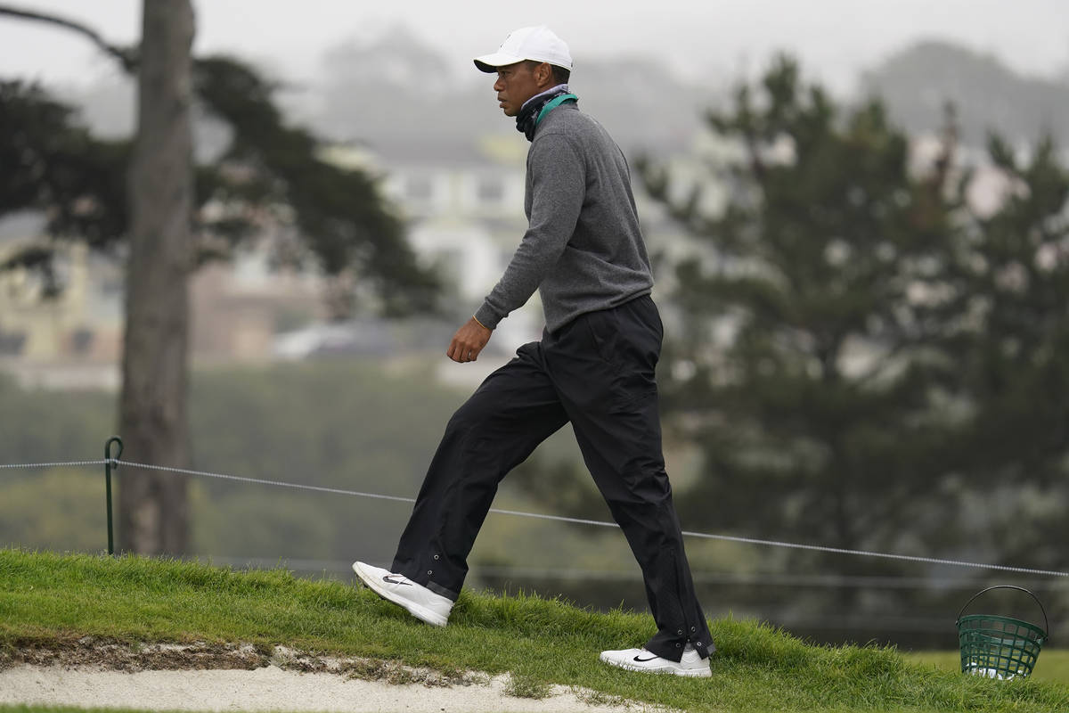 Tiger Woods walks along a green during practice for the PGA Championship golf tournament at TPC ...