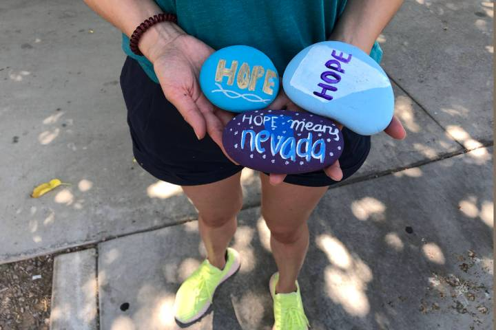 Angela Edgeworth holds rocks in Lorenzi Park in Las Vegas,Tuesday, Aug. 4, 2020. Edgeworth sist ...