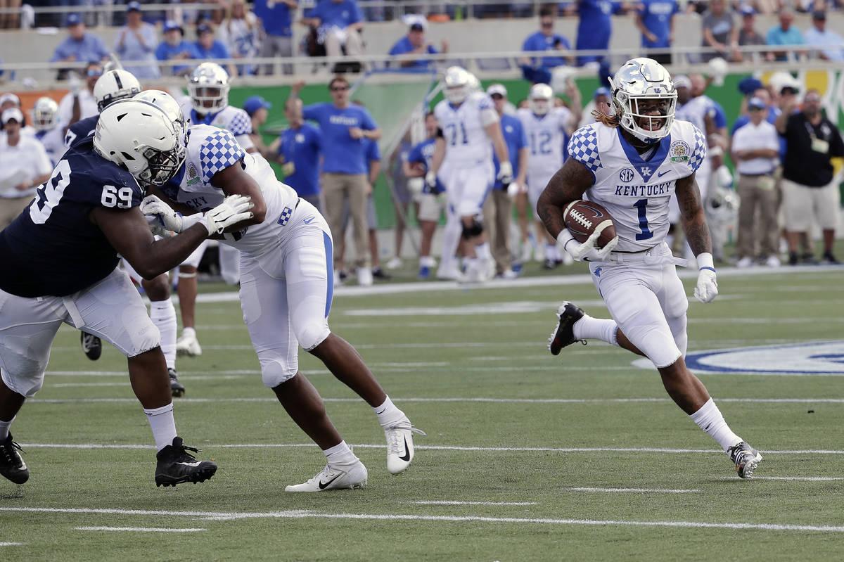 Kentucky's Lynn Bowden Jr. (1) returns a punt for a 58-yard touchdown as he gets past Penn Stat ...