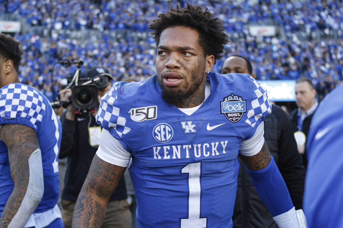 Kentucky's Lynn Bowden Jr. stands on the field after leading his team to a 37-30 victory over ...