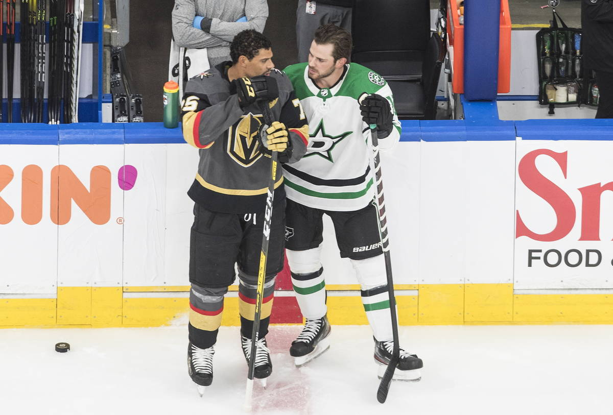 Dallas Stars' Tyler Seguin (91) and Vegas Golden Knights' Ryan Reaves (75) chat during warm ups ...