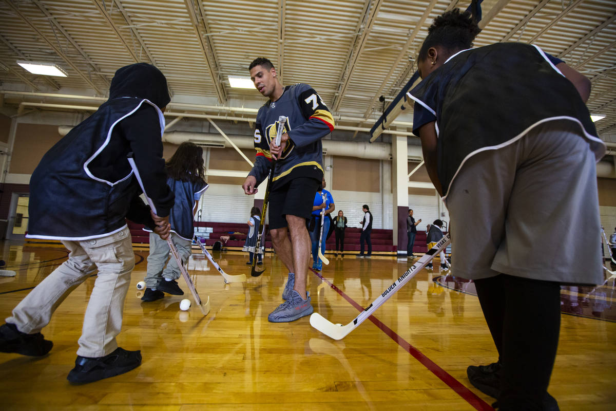 Golden Knights forward Ryan Reaves helps lead a youth street hockey clinic at Doolittle Recreat ...