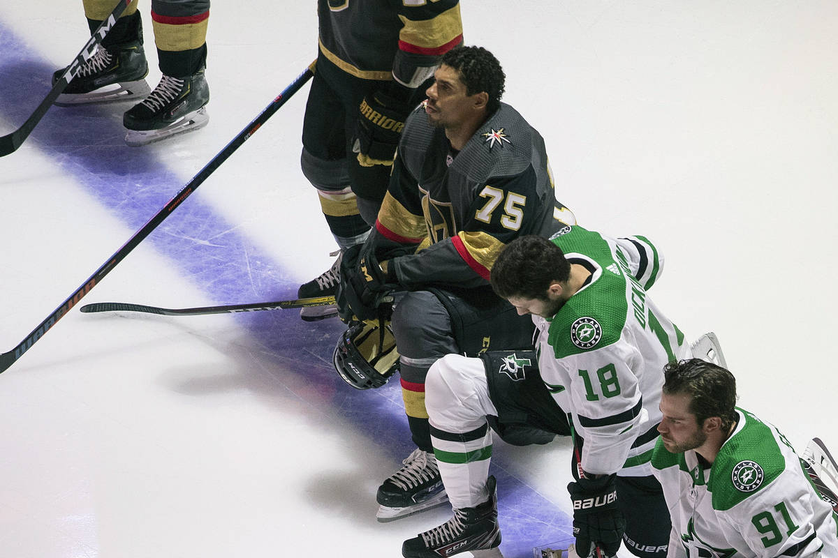 The Golden Knights' Ryan Reaves (75) is shown kneeling during the national anthems before an NH ...