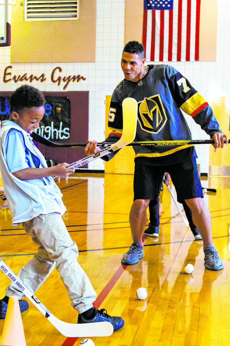 Golden Knights forward Ryan Reaves shows Javon Williams, 9, how to celebrate after scoring a go ...